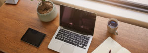 Header-Laptop-on-Desk-with-Coffee